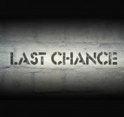 last chance stencil print on the grunge white brick wall